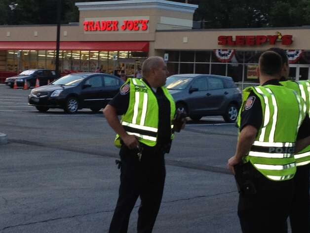 Police prepare for the rush of customers expected to visit Trader Joe's when the  grocery store opens its first Capital Region store at 8 a.m. Friday in Colonie. (Times Union)