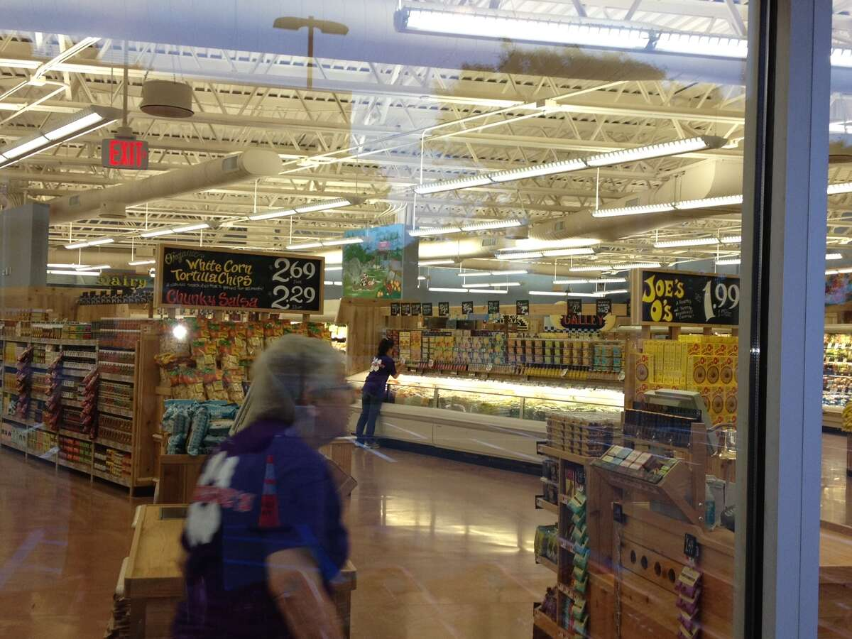 Trader Joe's employees on Friday prepare for the Wolf Road store's opening day. (Times Union)
