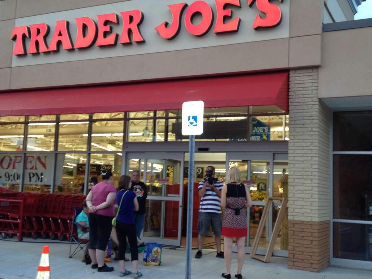 A small crowd starts to build on Friday outside the region's first Trader Joe's store. The grocery store opens at 8 a.m. (Times Union)