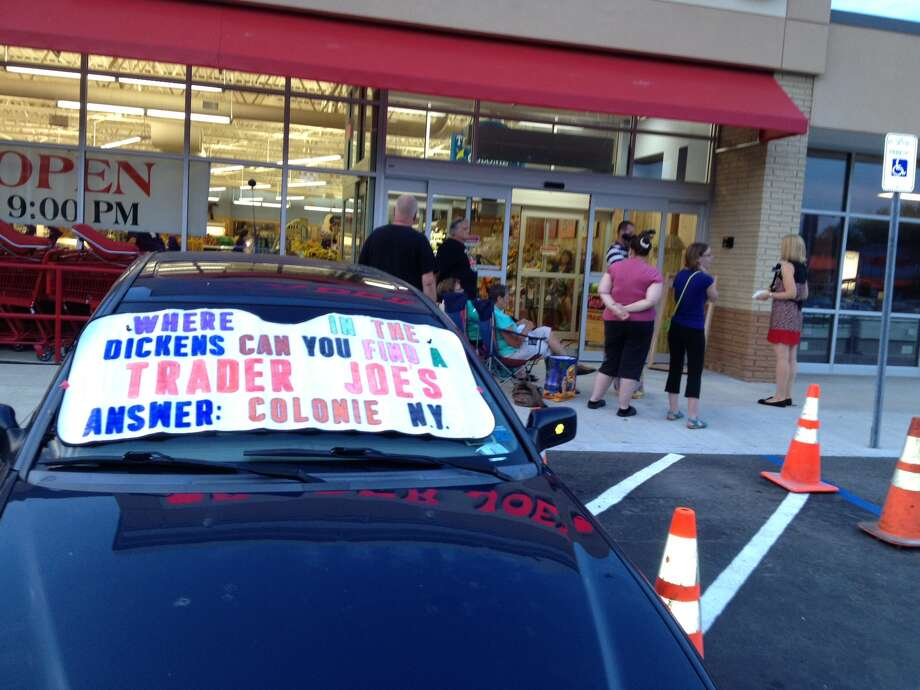 A sign in a car window heralds the Friday opening of the Trader Joe's on Wolf Road in Colonie. (Times Union)