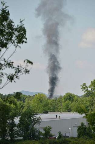 A plume of heavy black smoke can be seen rising from a chemical fire at TCI, a transformer recycling company in Ghent Thursday Aug. 2, 2012. (John Carl D'Annibale/ Times Union) Photo: John Carl D'Annibale / 00018700A