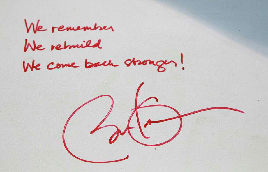 "President Barack Obama's signature and thoughts are shown on a steel beam prior to it's installation on the 104th floor of 1 World Trade Center, Thursday, Aug. 2, 2012 in New York. The beam was signed by the president with the notes: ""We remember,"" ''We rebuild"" and ""We come back stronger!"" during a ceremony at the construction site June 14. Since then the beam has been adorned with the autographs of workers and police officers at the site. The beam will be sealed into the structure of the tower, which is scheduled for completion in 2014. Photo: Mark Lennihan, AP / AP"