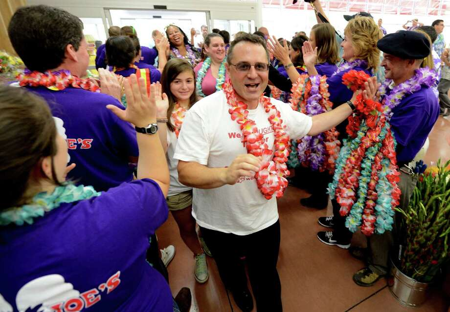 Bruce Roter, the driving force behind Trader Joe's coming to the area high fives crew members as he entered the new Trader Joe's that opened this morning on Wolf Road in Colonie, N.Y. August 3, 2012.     (Skip Dickstein/Times Union) Photo: Skip Dickstein / 00018677A