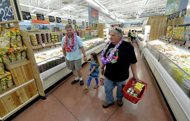 Ed Davis of Watervliet shops at the new Trader Joe's that opened this morning on Wolf Road in Colonie, N.Y. August 3, 2012.   Davis was the first in line to enter store after waiting from 10 p.m. the night before.  (Skip Dickstein/Times Union) Photo: Skip Dickstein / 00018677A