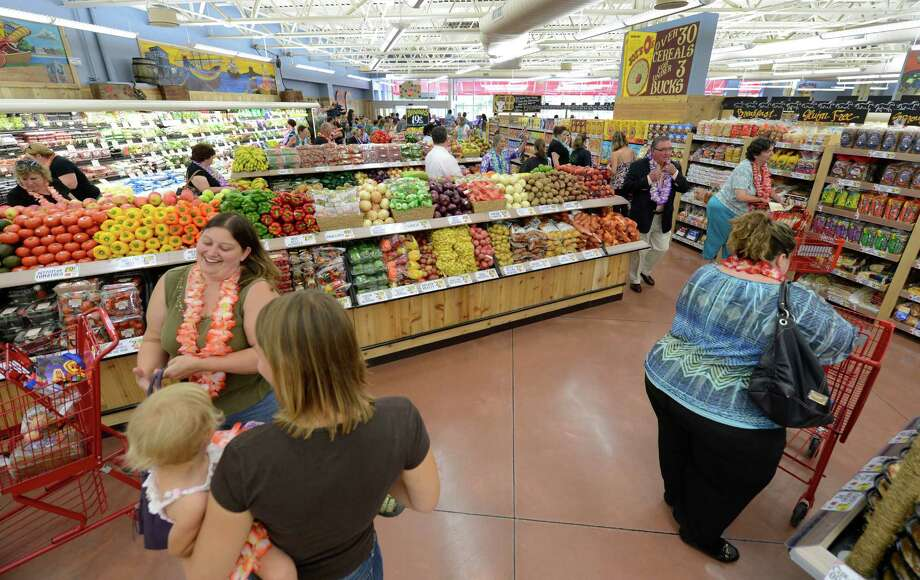 Shoppers swarm through the new Trader Joe's that opened this morning on Wolf Road in Colonie, N.Y. August 3, 2012.     (Skip Dickstein/Times Union) Photo: Skip Dickstein / 00018677A
