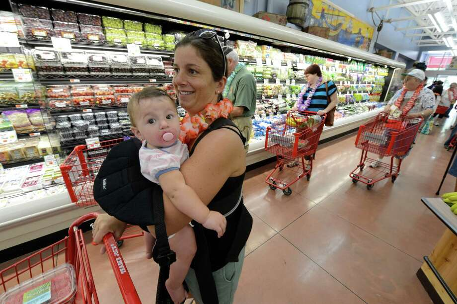 Janet Dragone carries her daughter nine month old Gianna while shopping at the new Trader Joe's that opened this morning on Wolf Road in Colonie, N.Y. August 3, 2012.     (Skip Dickstein/Times Union) Photo: Skip Dickstein / 00018677A
