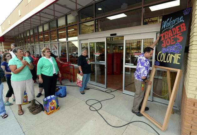 Patrons wait to get in to the new Trader Joe's that opened this morning on Wolf Road in Colonie, N.Y. August 3, 2012.     (Skip Dickstein/Times Union) Photo: Skip Dickstein / 00018677A