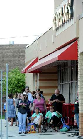 Shoppers wait in line to get in to the new Trader Joe's that opened this morning on Wolf Road in Colonie, N.Y. August 3, 2012.     (Skip Dickstein/Times Union) Photo: Skip Dickstein / 00018677A