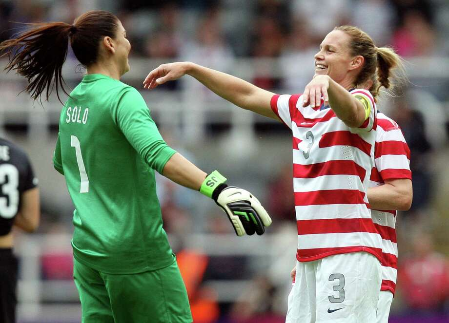 Christie Rampone, right, celebrates with Hope Solo, left, after they defeated New Zealand in a women's quarter-final soccer match at St James' Park in Newcastle, England, Friday. Photo: Ap