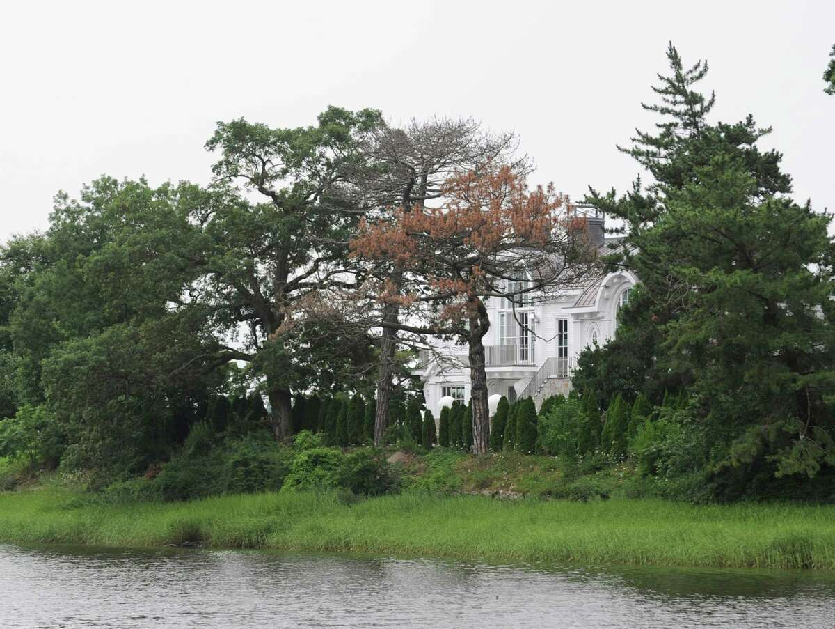The house at 18 Chimney Corner Lane, along Indian Harbor, one of the most exclusive estates currently on the market in Greenwich Wednesday, Aug. 1, 2012. Rumors are circulating that Tom Cruise is house-hunting in the tri-state area, including in Greenwich and other towns in lower Fairfield County, as well as in Westchester County, N.Y.