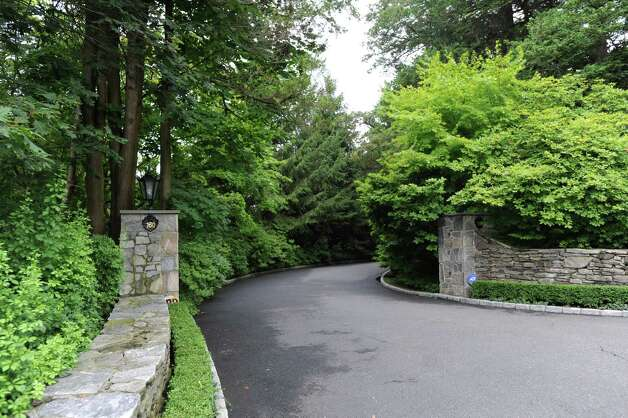 Entrance to the property at 164 Round Hill Road, one of the most exclusive estates currently on the market in Greenwich Wednesday, Aug. 1, 2012. Rumors are circulating that Tom Cruise is house-hunting in the tri-state area, including in Greenwich and other towns in lower Fairfield County, as well as in Westchester County, N.Y. Photo: Bob Luckey / Greenwich Time