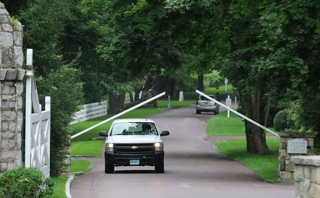 A truck passes through a raised gate leading to the property at 105 Conyers Farm Drive, one of the most exclusive estates currently on the market in Greenwich Wednesday, Aug. 1, 2012. Rumors are circulating that Tom Cruise is house-hunting in the tri-state area, including in Greenwich and other towns in lower Fairfield County, as well as in Westchester County, N.Y. Photo: Bob Luckey / Greenwich Time