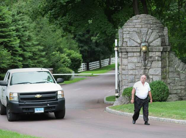 The security detail at the gate leading to the property at 105 Conyers Farm Drive, one of the most exclusive estates currently on the market in Greenwich Wednesday, Aug. 1, 2012. Rumors are circulating that Tom Cruise is house-hunting in the tri-state area, including in Greenwich and other towns in lower Fairfield County, as well as in Westchester County, N.Y. Photo: Bob Luckey / Greenwich Time
