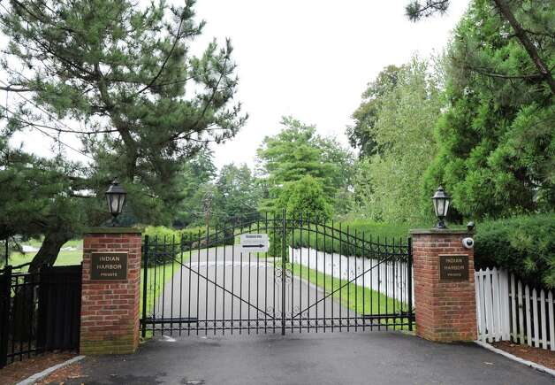 The Indian Harbor gate leading to the property at 18 Chimney Corner Lane, one of the most exclusive estates currently on the market in Greenwich Wednesday, Aug. 1, 2012. Rumors are circulating that Tom Cruise is house-hunting in the tri-state area, including in Greenwich and other towns in lower Fairfield County, as well as in Westchester County, N.Y. Photo: Bob Luckey / Greenwich Time