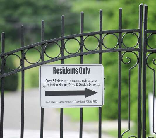 "The ""Residents Only"" sign on the Indian Harbor gate leading to the property at 18 Chimney Corner Lane, one of the most exclusive estates currently on the market in Greenwich Wednesday, Aug. 1, 2012. Rumors are circulating that Tom Cruise is house-hunting in the tri-state area, including in Greenwich and other towns in lower Fairfield County, as well as in Westchester County, N.Y. Photo: Bob Luckey / Greenwich Time"