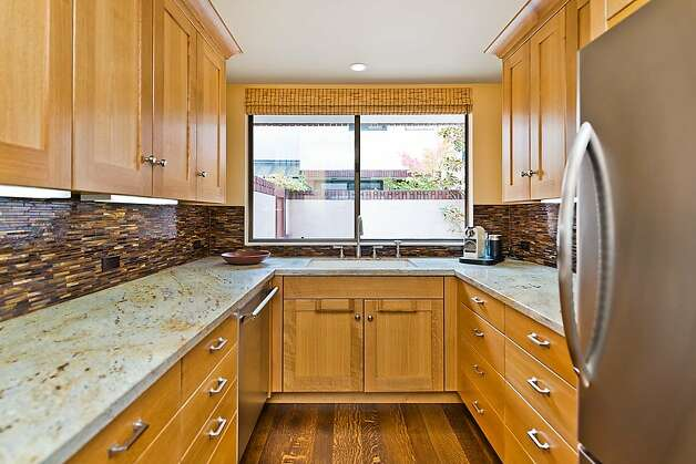 The kitchen's fine details include stainless steel appliances and a wide window over the kitchen sink area to enable the flow of natural light. Photo: Olga Soboleva