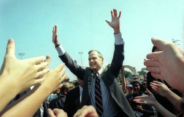 1992: President George Bush greets the crowd gathered at Nolan Field in Ansonia, Conn. Aug. 24th, 1992. Photo: Brian A. Pounds / Connecticut Post