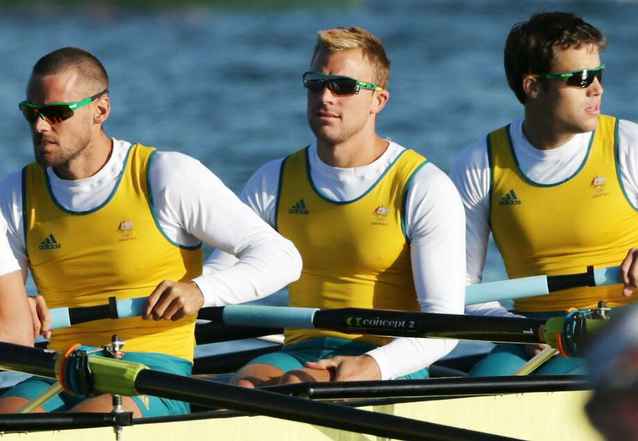 Australian rower Joshua Booth, center, was detained by police early morning on Aug. 2 in London for causing damage to a storefront in an alcohol-related incident hours after he competed in the men's eight at the Olympics. (Armando Franca / AP)