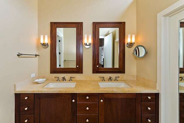 All three baths and the eat-in kitchen have new granite countertops. Photo: Olga Soboleva