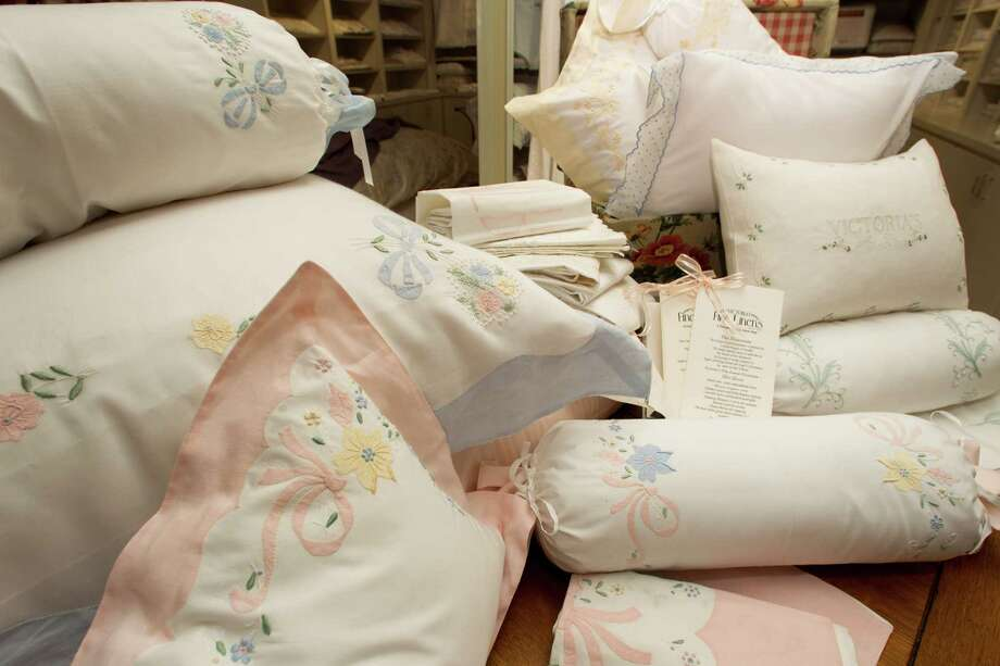 Embroidered linens add a touch of elegance to bedrooms. Photo: Brett Coomer, Houston Chronicle / © 2012 Houston Chronicle