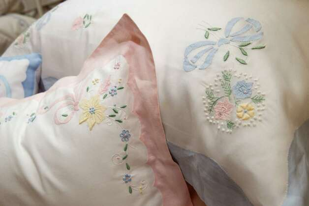 Embroidered pillow cases are shown at Victoria's Fine Linens Saturday, July 21, 2012, in Houston. ( Brett Coomer / Houston Chronicle ) Photo: Brett Coomer, Houston Chronicle / © 2012 Houston Chronicle