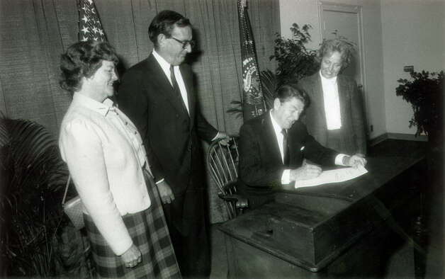 1984: President Ronald Reagan signs a bill into law designating islands off of Norwalk, Milford Point and Guilford as wildlife refuges. He is joined here by Rep. Stewart McKinney and his wife Lucie, left, and Rep. Nancy Johnson. Photo: File Photo / Connecticut Post File Photo
