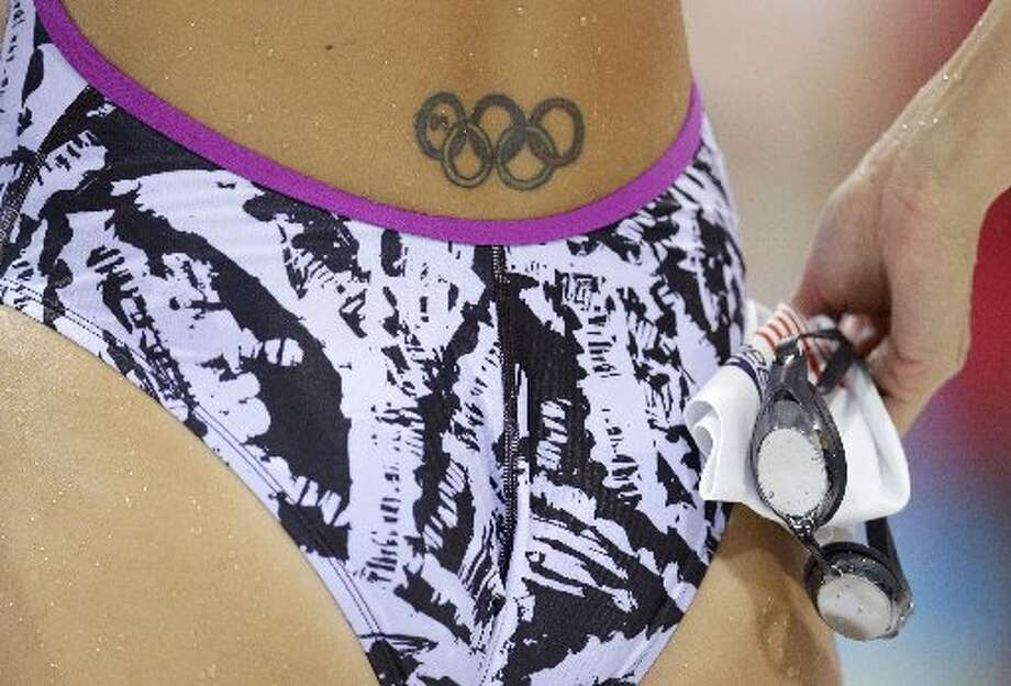U.S. swimmer Dana Vollmer's tattoo is visible from the back.  (AP)