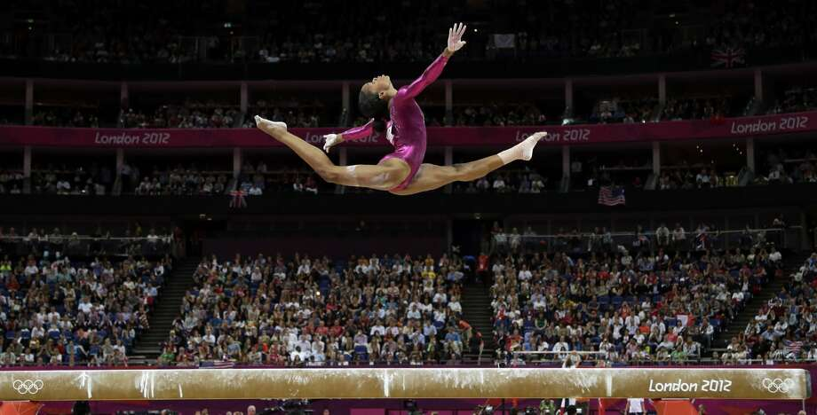 U.S. gymnast Gabrielle Douglas performs on the balance beam during the artistic gymnastics women's individual all-around competition at the 2012 Summer Olympics, Thursday, Aug. 2, 2012, in London. (AP Photo/Gregory Bull) (AP)