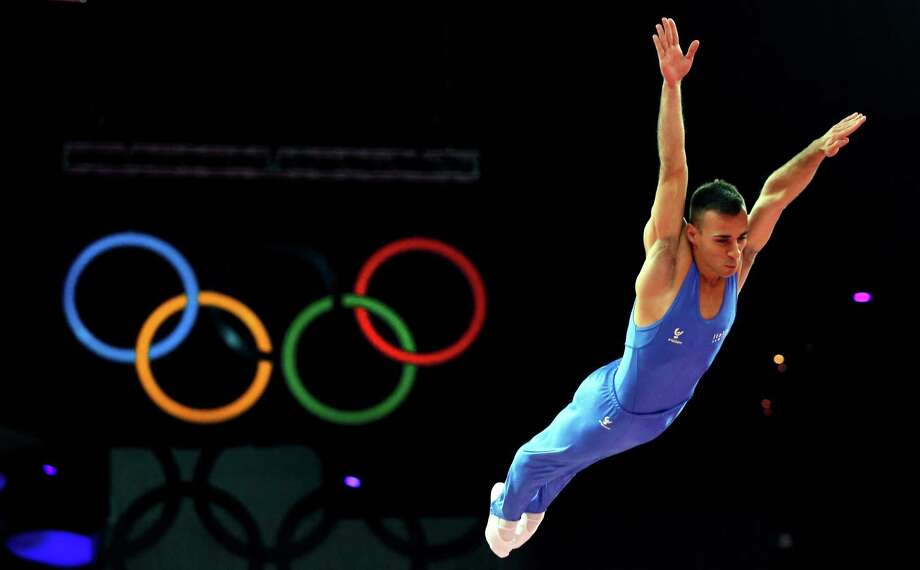 Italy's Flavio Cannone competes in the men's trampoline final of the artistic gymnastics event of the London 2012 Olympic Games in London on August 3, 2012. China's Dong Dong won the gold, Russia's Dmitry Ushakov the silver and China's Lu Chunlong bronze. AFP PHOTO / THOMAS COEXTHOMAS COEX/AFP/GettyImages Photo: THOMAS COEX, AFP/Getty Images / AFP