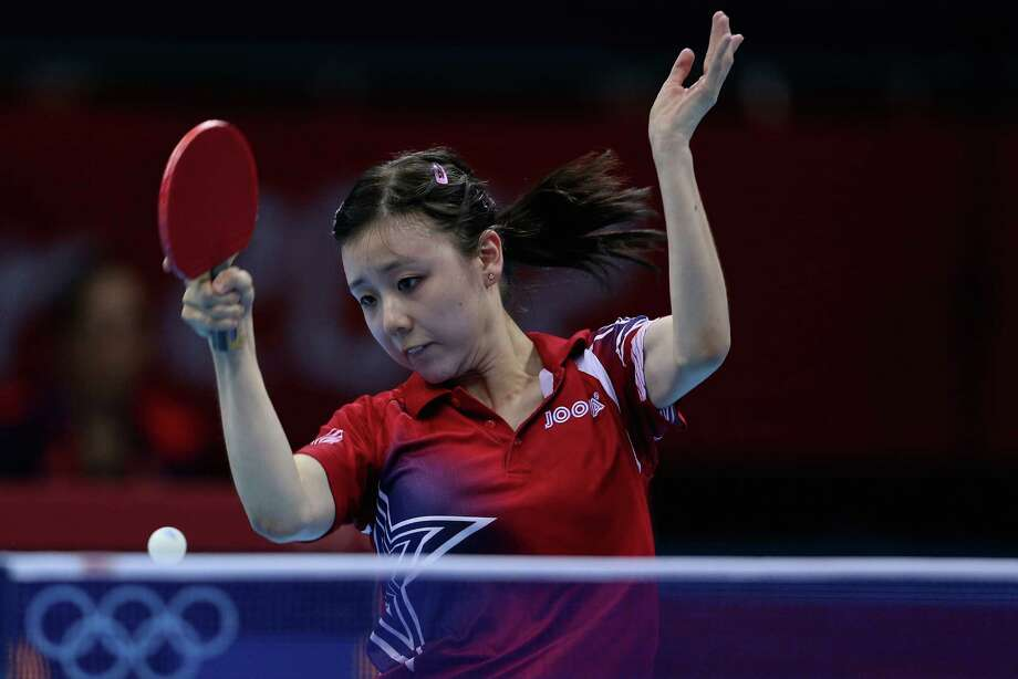 LONDON, ENGLAND - AUGUST 03:  Ariel Hsing of United States completes during Women's Team Table Tennis first round match against team of Japan on Day 7 of the London 2012 Olympic Games at ExCeL on August 3, 2012 in London, England. Photo: Feng Li, Getty Images / 2012 Getty Images