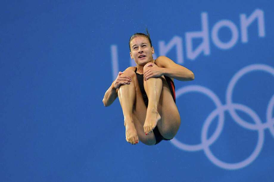 Hungary's Flora Gondos competes in the preliminary round of the women's 3m springboard diving event at the London 2012 Olympic Games in the Aquatics Centre in London on August 3, 2012.  AFP PHOTO / FABRICE COFFRINIFABRICE COFFRINI/AFP/GettyImages Photo: FABRICE COFFRINI, AFP/Getty Images / AFP