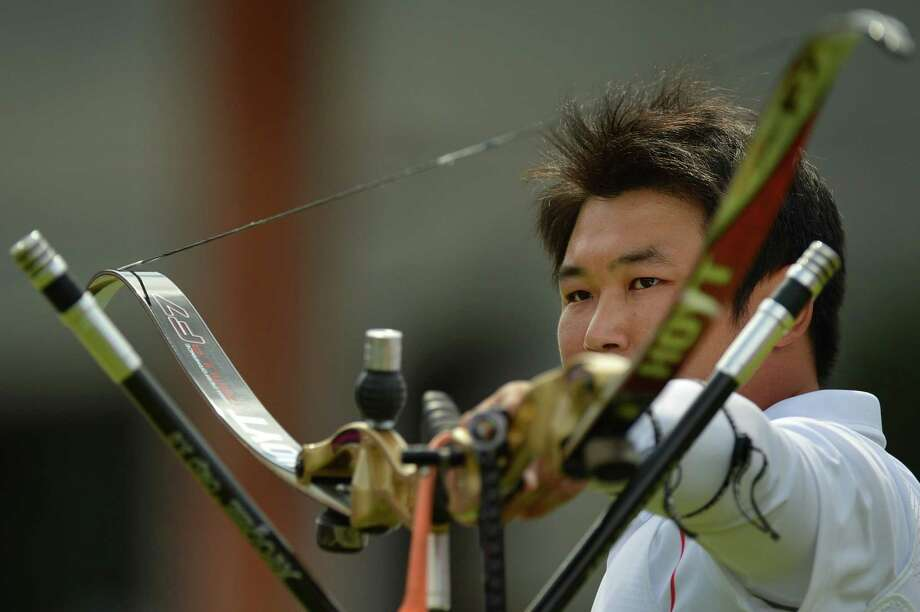 Oh Jinhyek of South Korea competes against Dai Xiaoxiang of China during the Men's Individual Archery Semi-final Match on day 7 of the London 2012 Olympic Games at Lord's Cricket Ground in London on August 3, 2012. AFP PHOTO / BEN STANSALLBEN STANSALL/AFP/GettyImages Photo: BEN STANSALL, AFP/Getty Images / AFP