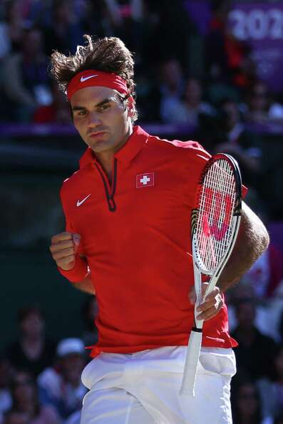 LONDON, ENGLAND - AUGUST 03:  Roger Federer of Switzerland celebrates a point against Juan Martin De