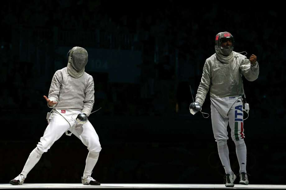 LONDON, ENGLAND - AUGUST 03:  Aldo Montano (R) of Italy competes against Nikolay Kovalev of Russia during the Men's Sabre Team Fencing on Day 7 of the London 2012 Olympic Games at ExCeL on August 3, 2012 in London, England. Photo: Ronald Martinez, Getty Images / 2012 Getty Images