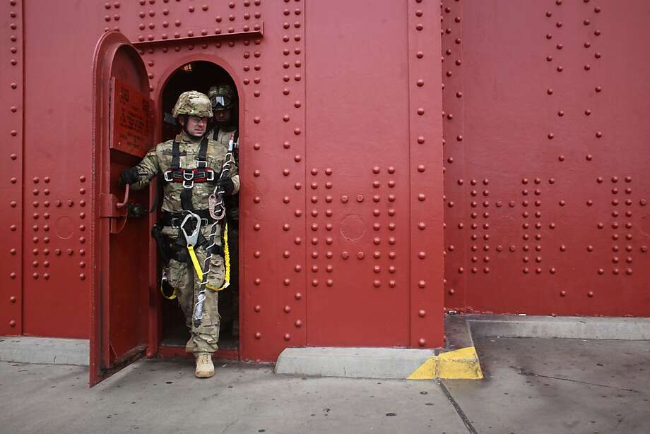 California Highway Patrol SWAT team members exit the Golden Gate Bridge's south tower after a climber was detained. Photo: Mike Kepka, The Chronicle