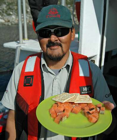 A park staff member offers Arctic char sushi. Photo: Bill Fink, Special To The Chronicle