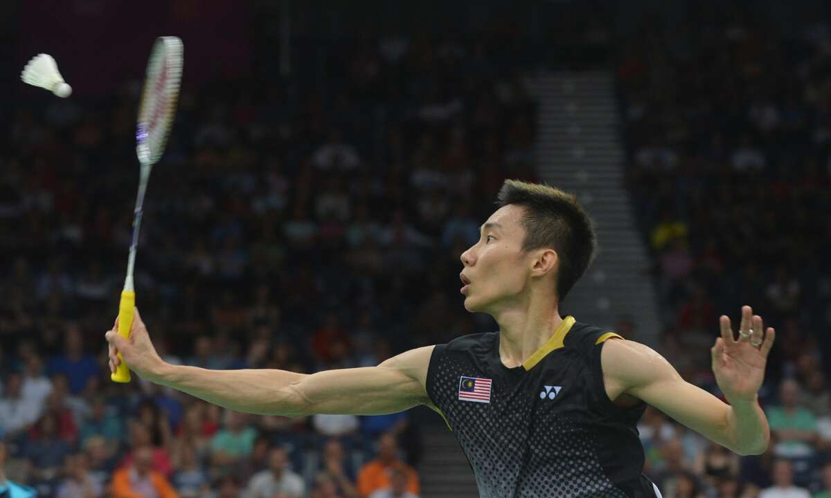 Badminton made its debut as a demonstration sport at the 1972 Olympic Games in Munich. It was not until the 1992 Games in Barcelona that it was officially included on the Olympic program, with men's and women's singles and doubles events. The mixed doubles event made its debut in 1996 at the Atlanta Olympic Games. Here, Malaysia's Lee Chong Wei returns a shot to Simon Santoso of Indonesia during their men's singles badminton match at the London 2012 Games. (ADEK BERRY / AFP/Getty Images)