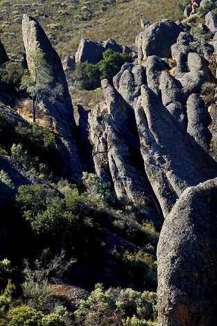 Jagged rocks dot the landscape along Bear Gulch, at Pinnacles National Monument, on Wednesday August 1, 2012,  in central California. Pinnacles would become the 59th U.S. national park under a bill that cleared the House on Tuesday with bipartisan support. The bill creating Pinnacles National Park is aimed at raising the national profile of the site, named a monument by President Theodore Roosevelt in 1908. Photo: Michael Macor, The Chronicle