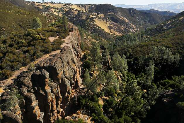 Visible is a trail along Bear Gulch at Pinnacles National Monument, on Wednesday August 1, 2012,  in central California. Pinnacles would become the 59th U.S. national park under a bill that cleared the House on Tuesday with bipartisan support. The bill creating Pinnacles National Park is aimed at raising the national profile of the site, named a monument by President Theodore Roosevelt in 1908. Photo: Michael Macor, The Chronicle