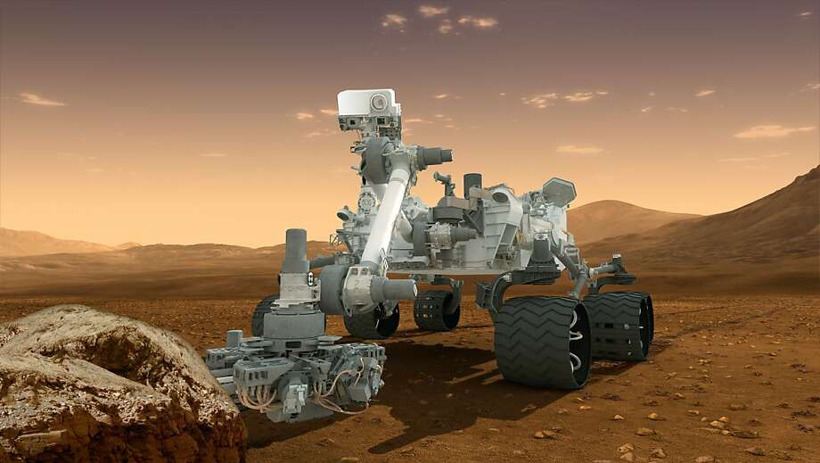 """This NASA handout image obtained August 1, 2012 shows an artist's conception of NASA's Mars Science Laboratory Curiosity rover, a mobile robot for investigating Mars' past or present ability to sustain microbial life.  Curiosity is scheduled to land on Mars August 5, 2012 PDT (Aug. 6 EDT).  AFP PHOTO/HANDOUT/  NASA/JPL-Caltech/ASU                = RESTRICTED TO EDITORIAL USE - MANDATORY CREDIT """" AFP PHOTO / NASA/JPL-Caltech/ASU  """" - NO MARKETING NO ADVERTISING CAMPAIGNS - DISTRIBUTED AS A SERVICE TO CLIENTS =HO/AFP/GettyImages Photo: Ho, AFP/Getty Images"""