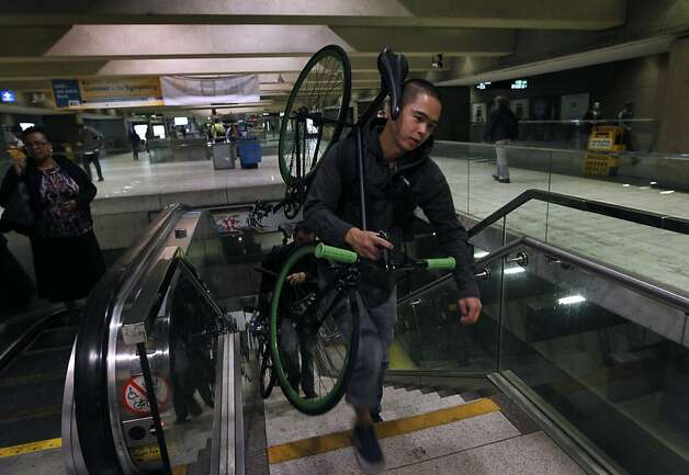 Mino Bautista arrives at the Embarcadero BART station in San Francisco, Calif. on Friday, Aug. 3, 2012 after commuting with his bicycle from Richmond. The transit agency is allowing bicyclists to board all trains during the commute rush hour as an experiment on Fridays during the month of August. Photo: Paul Chinn, The Chronicle