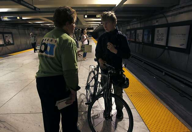 BART general manager Grace Crunican speaks with bicycle commuter Logan Kahle at the Embarcadero station in San Francisco, Calif. on Friday, Aug. 3, 2012. The transit agency is allowing bicyclists to board all trains during the commute rush hour as an experiment on Fridays during the month of August. Photo: Paul Chinn, The Chronicle