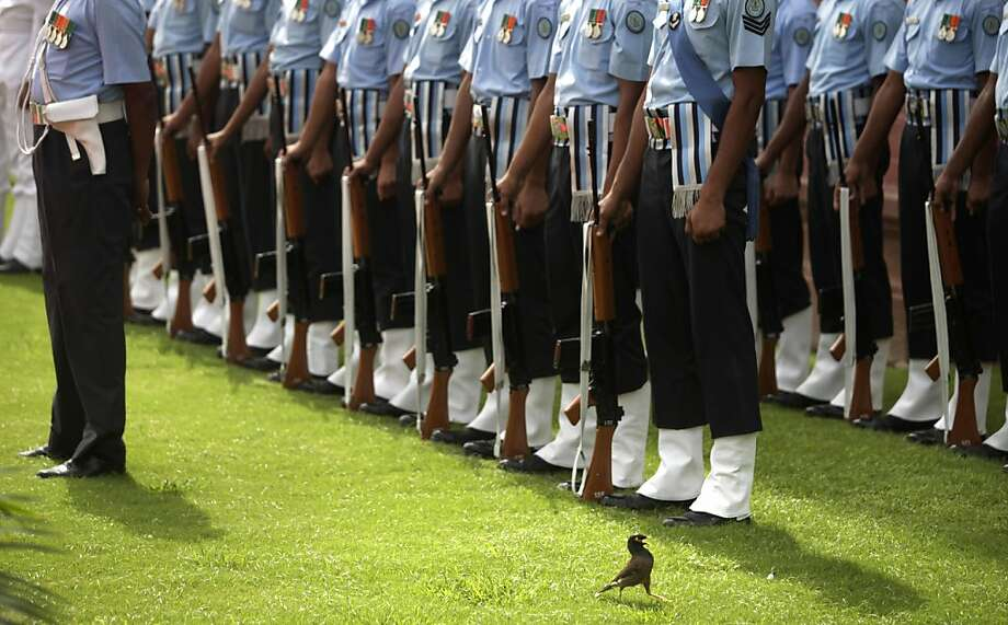 Ten-HUT!A bird colonel inspects the troops during an Indian Air Force honor guard review at the Defense Ministry in New Delhi. Photo: Altaf Qadri, Associated Press