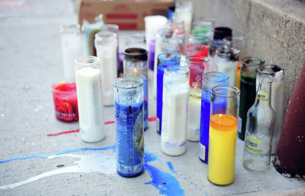 A memorial is set up on Hallett Street in Bridgeport Friday, August 3, 2012 where 17-year-old Gary Gullap was killed in a drive by shooting on Thursday afternoon. Photo: Autumn Driscoll / Connecticut Post