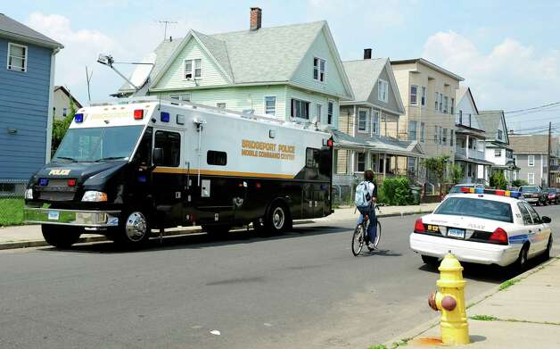 The Bridgeport Police Mobile Command Center is stationed at Brooks and Stillman Streets in Bridgeport Friday, August 3, 2012 following the shooting death of 17-year-old Gary Gullap on Hallett Street Thursday afternoon. Photo: Autumn Driscoll / Connecticut Post