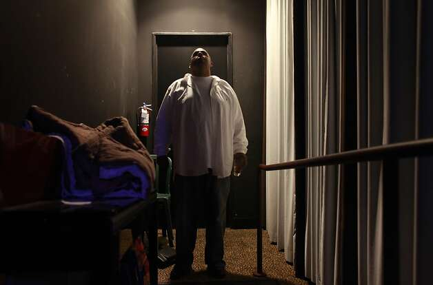 Local comedian, Marvellus Lucas, takes a deep breath before heading on stage at Tommy T's Showroom on Thursday July 26, 2012 in San Francisco, Calif. Photo: Mike Kepka, The Chronicle