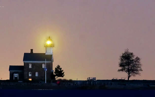 The Norwalk Seaport Association lit the 143-year old Sheffield Island Lighthouse for the first time in over 100 years Monday, Oct. 17, 2011. Photo: Keelin Daly / Stamford Advocate