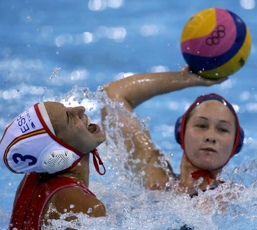 Spanish water polo player Anna Espar Llaquet (left) (Julio Cortez / Associated Press)