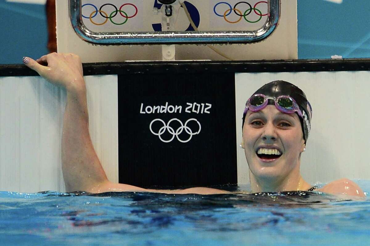 Missy Franklin reacts after winning gold and breaking the world record Friday in the 200-meter backstroke.