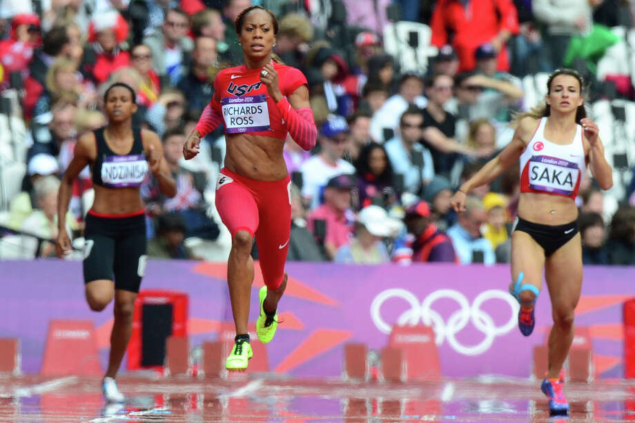 Former UT standout Sanya Richards-Ross (center) competes in a first-round heat of the women's 400 meters. Photo: OLIVIER MORIN, AFP/Getty Images / AFP